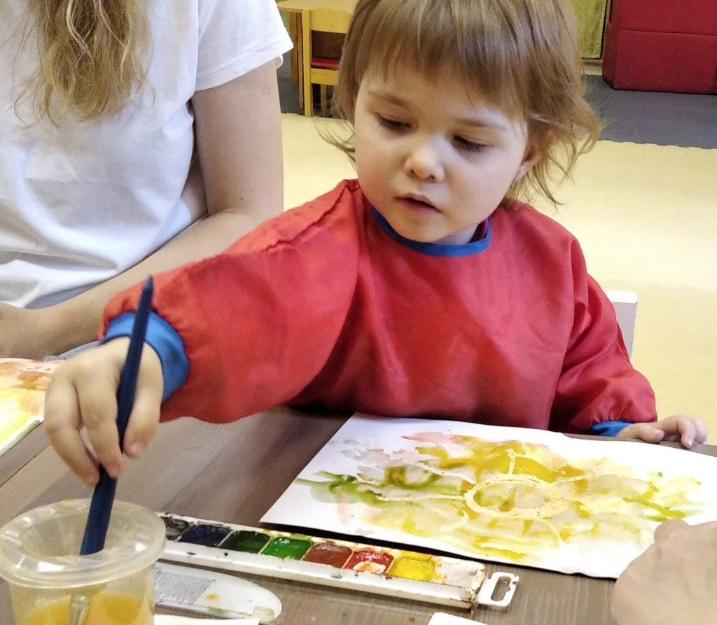 Milana painting at our Club for deaf children